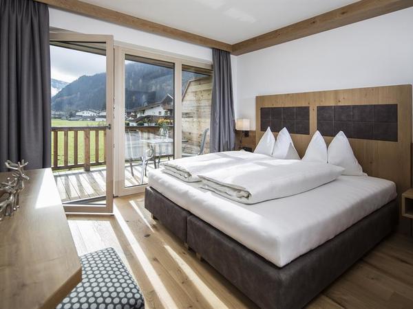 Alpinliving.Tirol Schlafzimmer Adlerhorst u. Gipfe