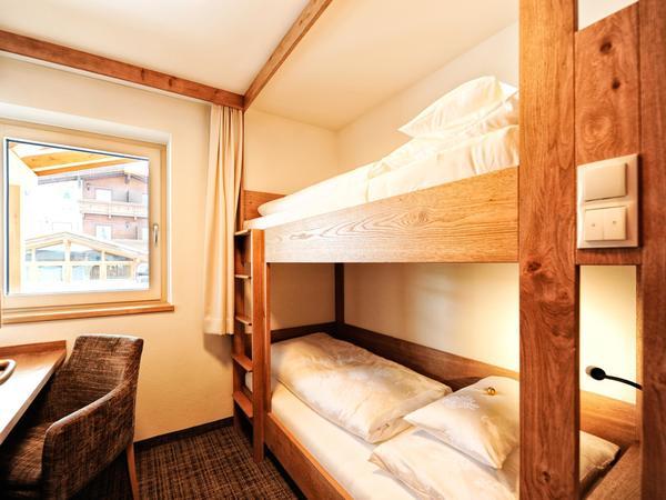 Neubau---4-Bett-Kinderzimmer_FPM7414_be