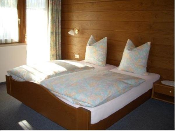 Ferienwohnungen Rinker Schlafzimmer Top 1