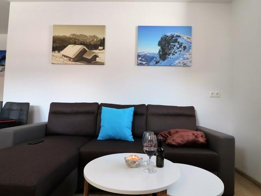 Wohnzimmer mit Sitzecke. (© Pfandl Tom)