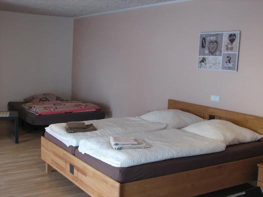 Doppelbettzimmer mit Schlafsofa