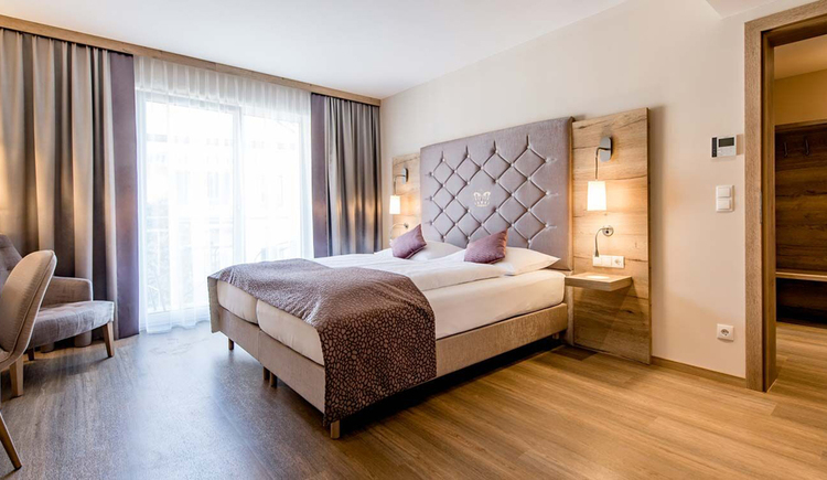 Double bed, on the side a large balcony door