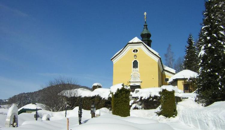 Kirche im Winter (© TVB Fuschlseeregion - Ortsbüro Ebenau)