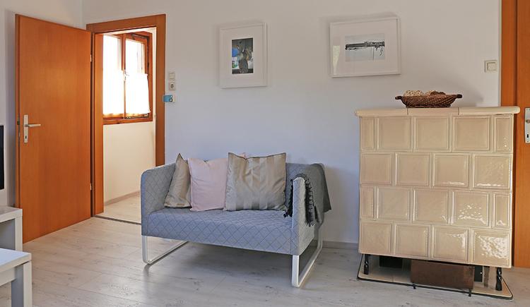Door, bench, tiled stove