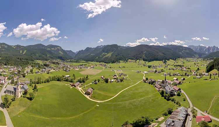 A view over the Gosau valley with the two churches in the foreground and the \
