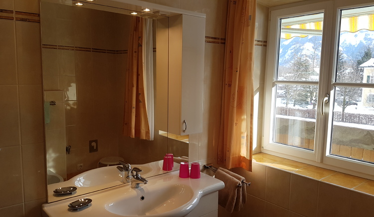 Bathroom with WC, shower and bidet.