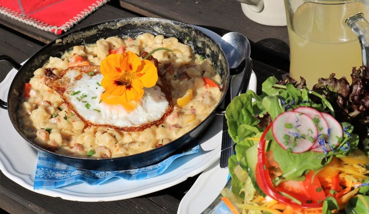 Austria is known for its traditional cuisine, hearty Kasspatz'n im Pfandl are a typical dish of the region.