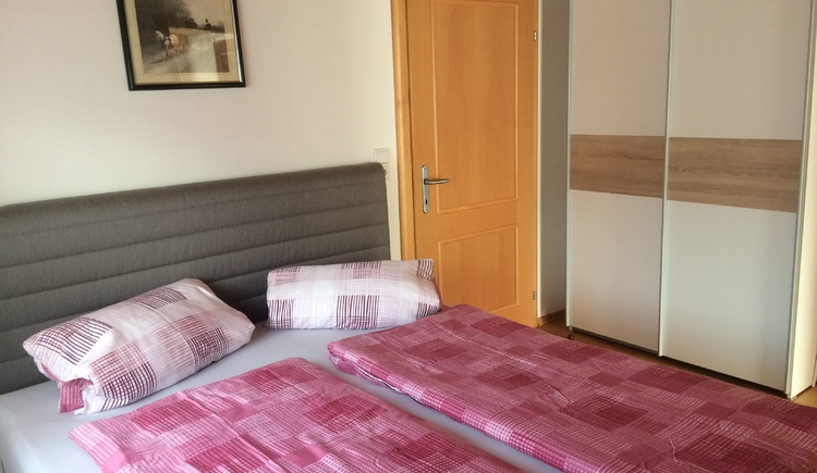 In this picture you can see the bedroom for two, with a double bed.