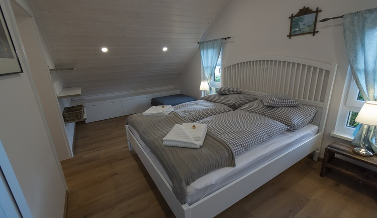 Also in the upstairs bedroom, wood is main material used for the interiour design.