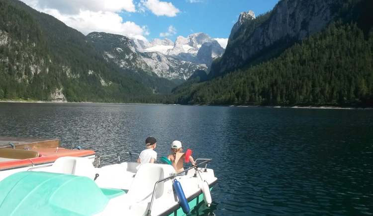 Pedal boat ride on the Gosau Lake with a great view on the mountain Dachstein.