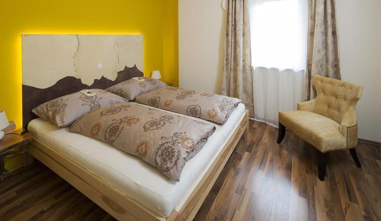 Schlafzimmer in der Ferienwohnung Hirscherl (© Kornek)