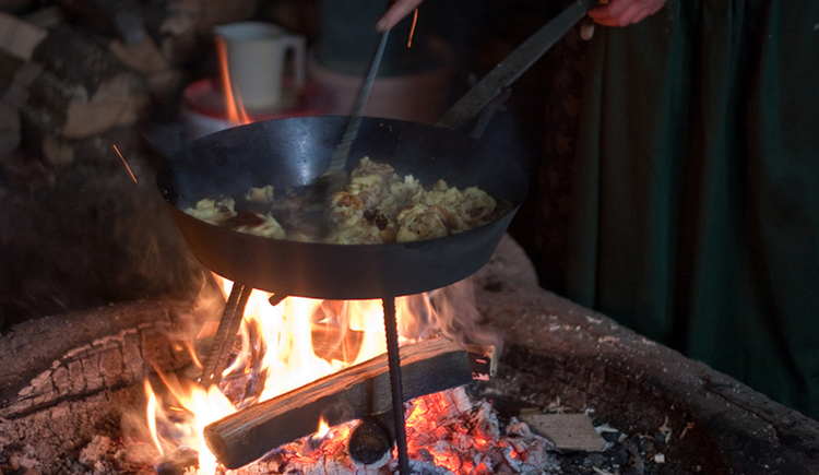 Cooking over the open fire in a pan
