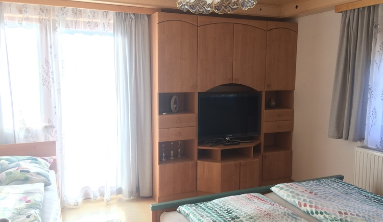 Here you see the three bed bedroom, with TV and access to the terrace.
