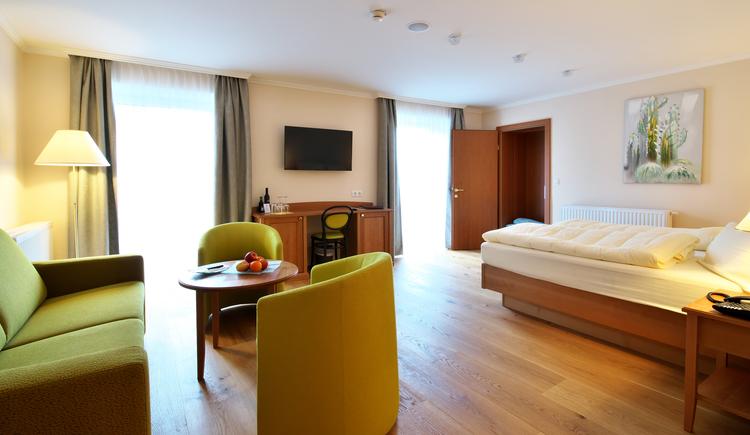 Doppelzimmer mit Holzboden
