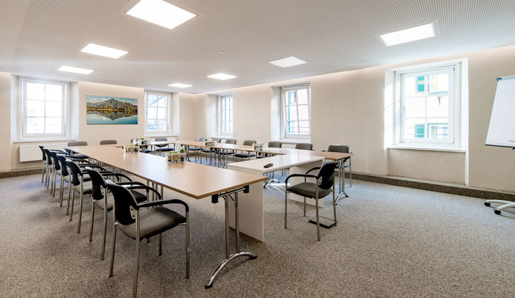 Meeting room with tables, chairs and flip-charts