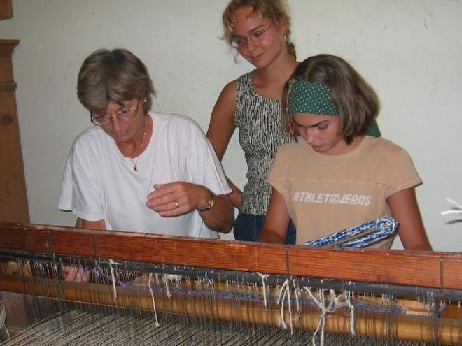 Weaving a carpet at the hand weaving mill Sickinger