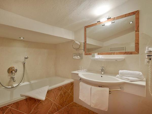 Bath room type A+ hotel Glockenstuhl in Gerlos