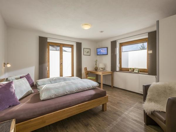 Schlafzimmer I - Ferienwohnung Roessler