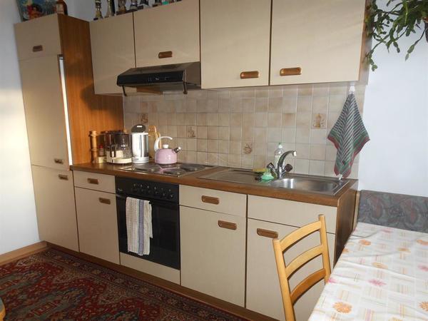 Küche mit Couch und Eckbank