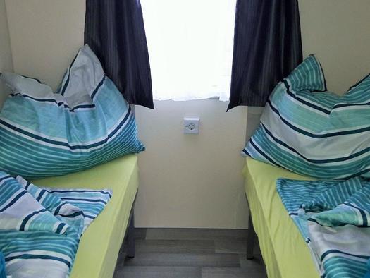 1. Schlafraum mit 2 getrennten Betten (© TVB Böhmerwald | Felhofer)