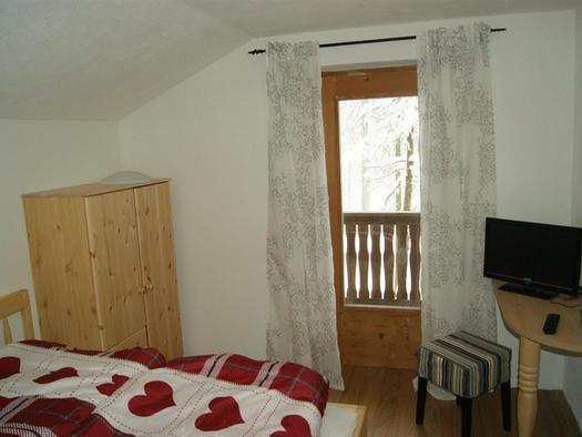 Schlafzimmer mit Ausblick auf der Kreitalm (© Kreitalm)