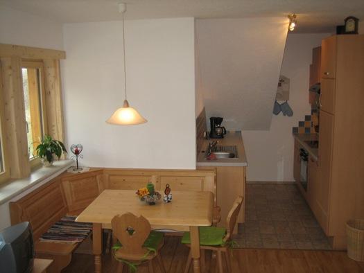 Die Wohnküche mit gemütlicher Sitzecke