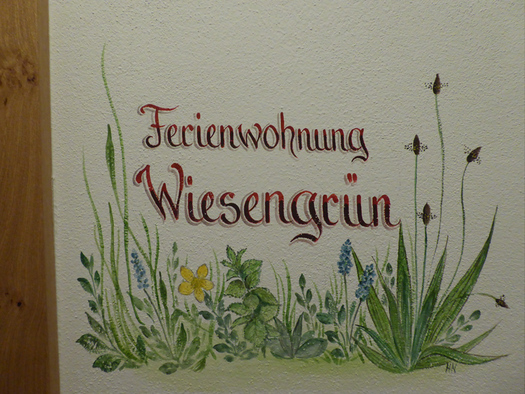 Wallpainting with flowers and the writing \