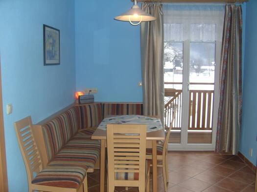 Familienzimmer `Enzian` - Sitzecke. (© seekda)