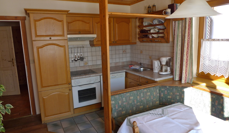 Fully equipped kitchen with cozy dining area and corner seat