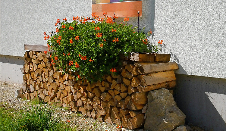 Woodpile decorated with flowers