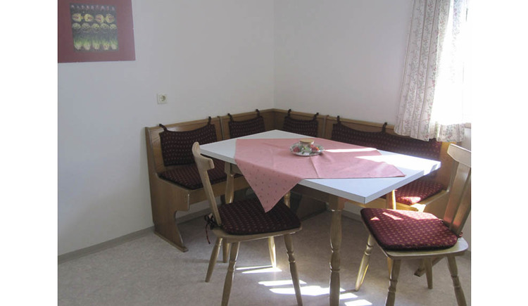 Dining area with corner bench, table and chairs