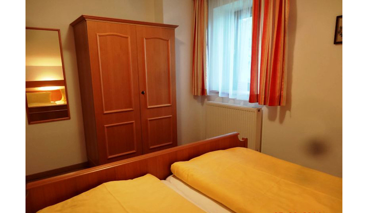double bedroom with wardrobe, window in the background