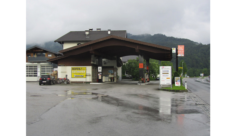 Gas station with parking place, in the background mountains