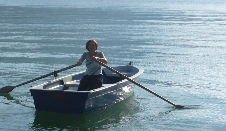 person in the rowboat on the lake