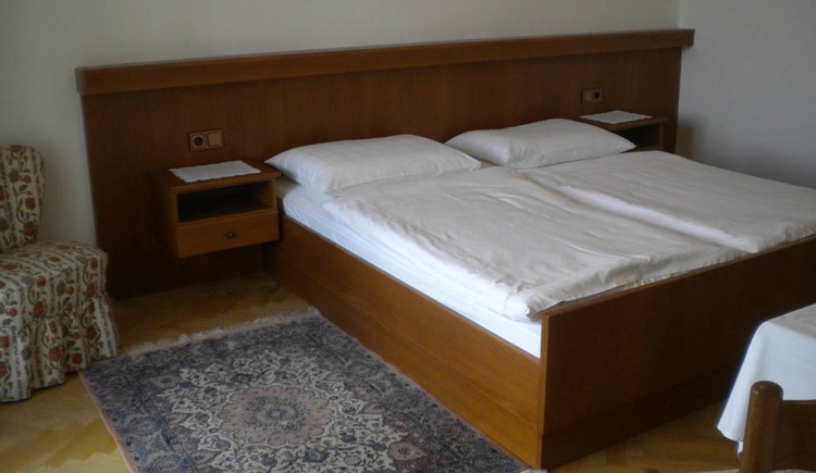 Bedroom with double bed and nightstand