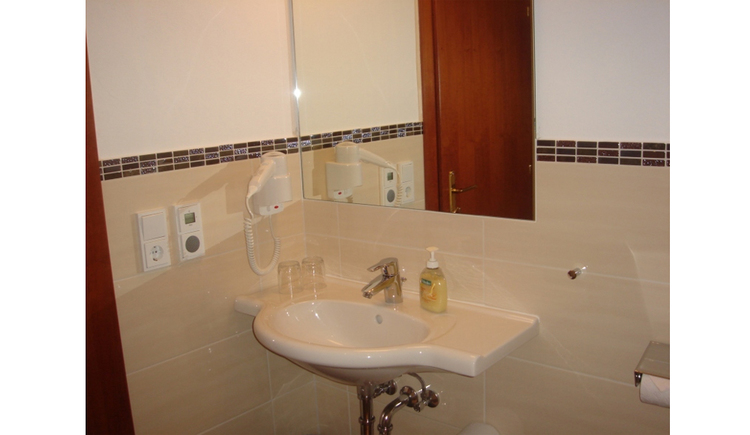 Washbasin, a hairdryer on the side
