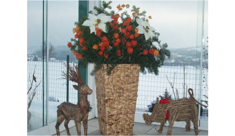 Christmas decoration, reindeer, wild boar, in the background outdoors snowy landscape