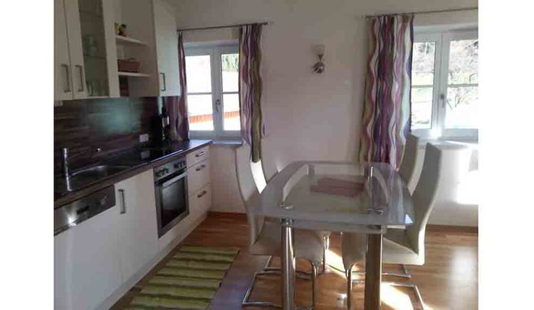 living area with kitchen, cooker, dishwasher, table, chairs