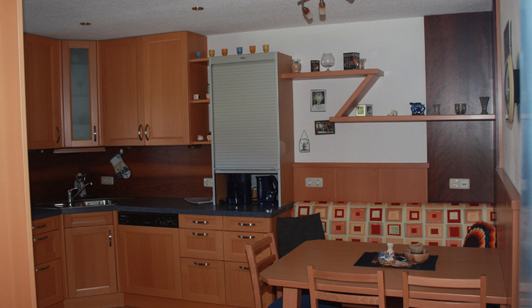 The kitchen with the seating area.