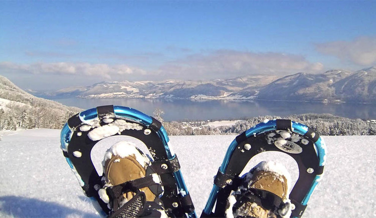 "snow shoes, look at the Wolfgangsee and the house mountain ""Hochplettspitz\"""