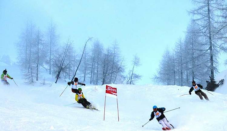 skiers driving a race