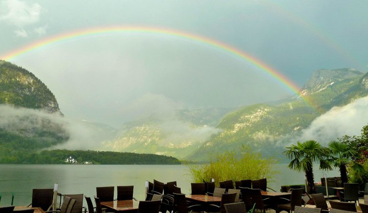 A beautiful rainbow stretches across the Lake Hallstatt.
