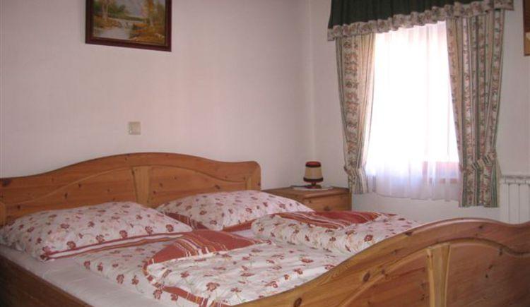 Schlafzimmer. (© Tourismusverband Ebenau)