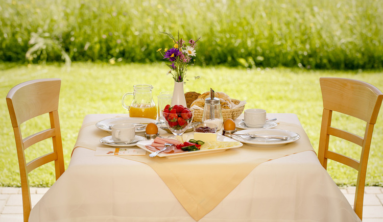 Covered breakfast table in the garden