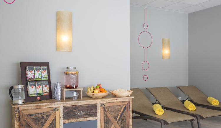 relaxation room with drinks and a fruit buffet