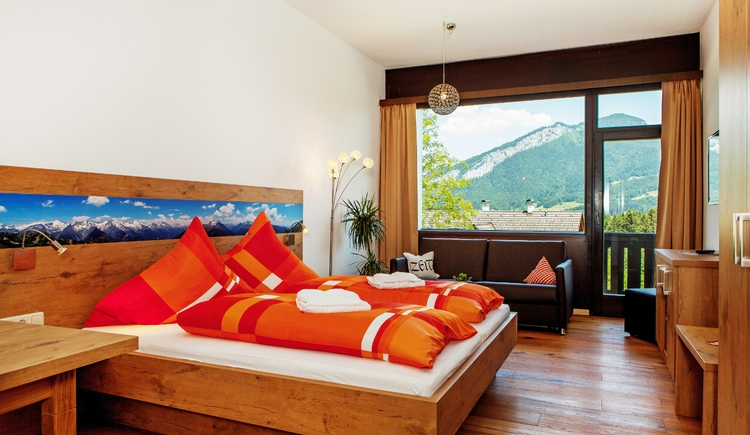 Enjoy your stay in the comfort room with balcony and magnificent view of the mountains