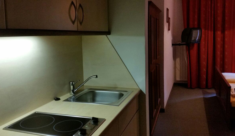 Small kitchenette: stove, sink