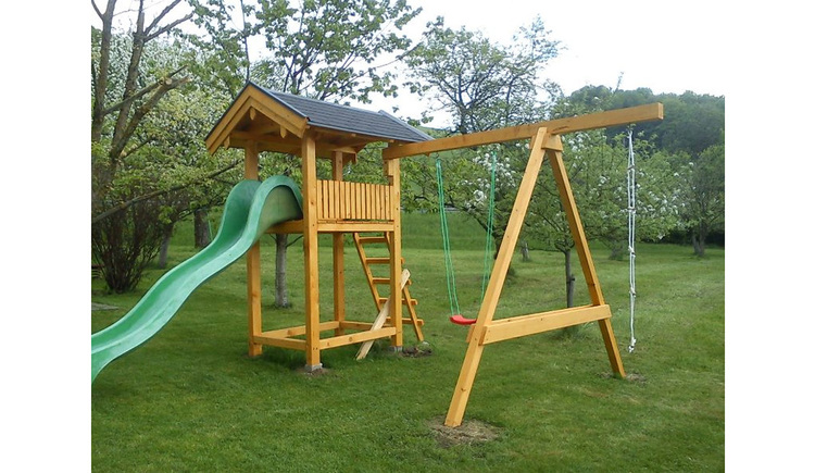 Slide and swing in the meadow