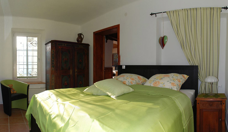 The bedroom with a double bed in the Apartment in Hallstatt