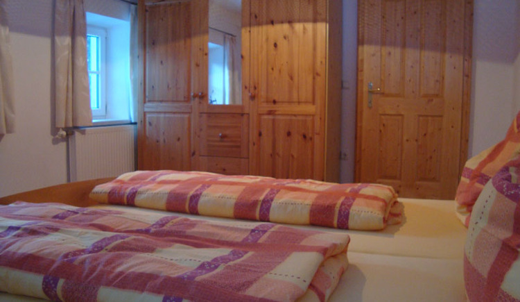 Bedroom with double bed and large wardrobe